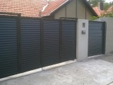 Automatic bi fold swing gate