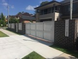 White bi fold gate for home