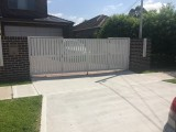 Front view of white bi fold gate