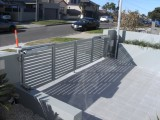 Automatic bi fold swing gate